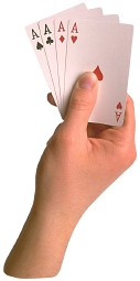 hand holding 4 aces playing cards