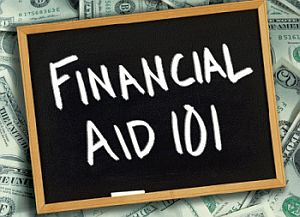 Chalkboard with the words FINANCIAL AID  101 laid on top of a pile of money