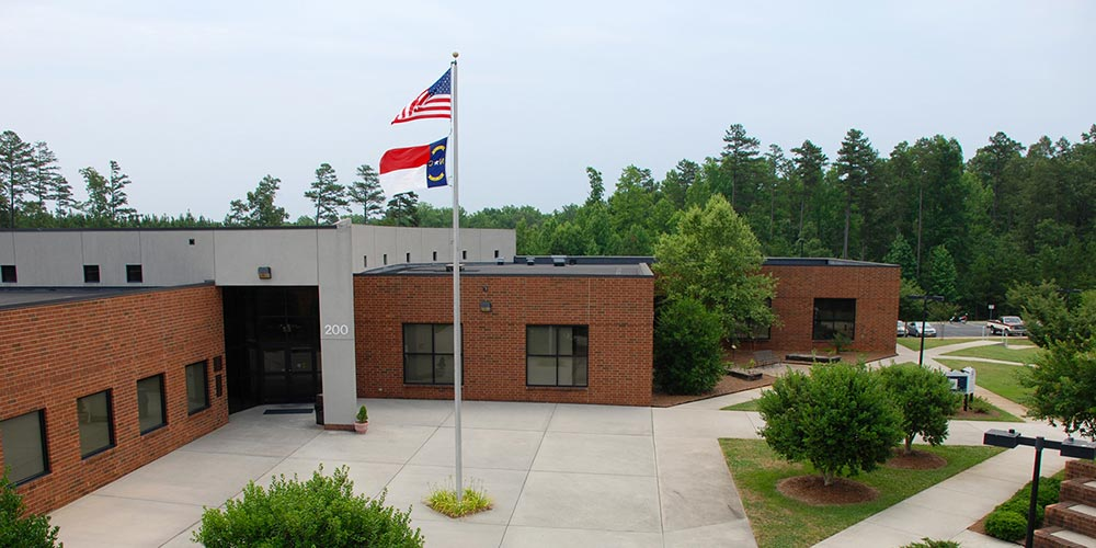 Aerial view of Building 200 with US and State flag flying